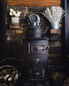 Black rustic cellar stove in Glasgow