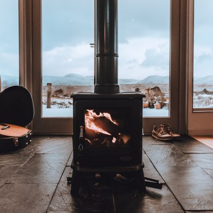 Sleek, modern stove in Glasgow home looking out to a seaside view