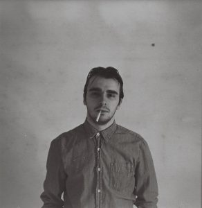 Man Smoking a Cigarette which is Bad For His Skin