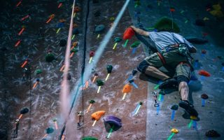 Two people rock climbing at a centre on a date