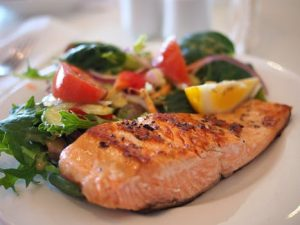 Salmon salad on a plate as part of a healthy diet